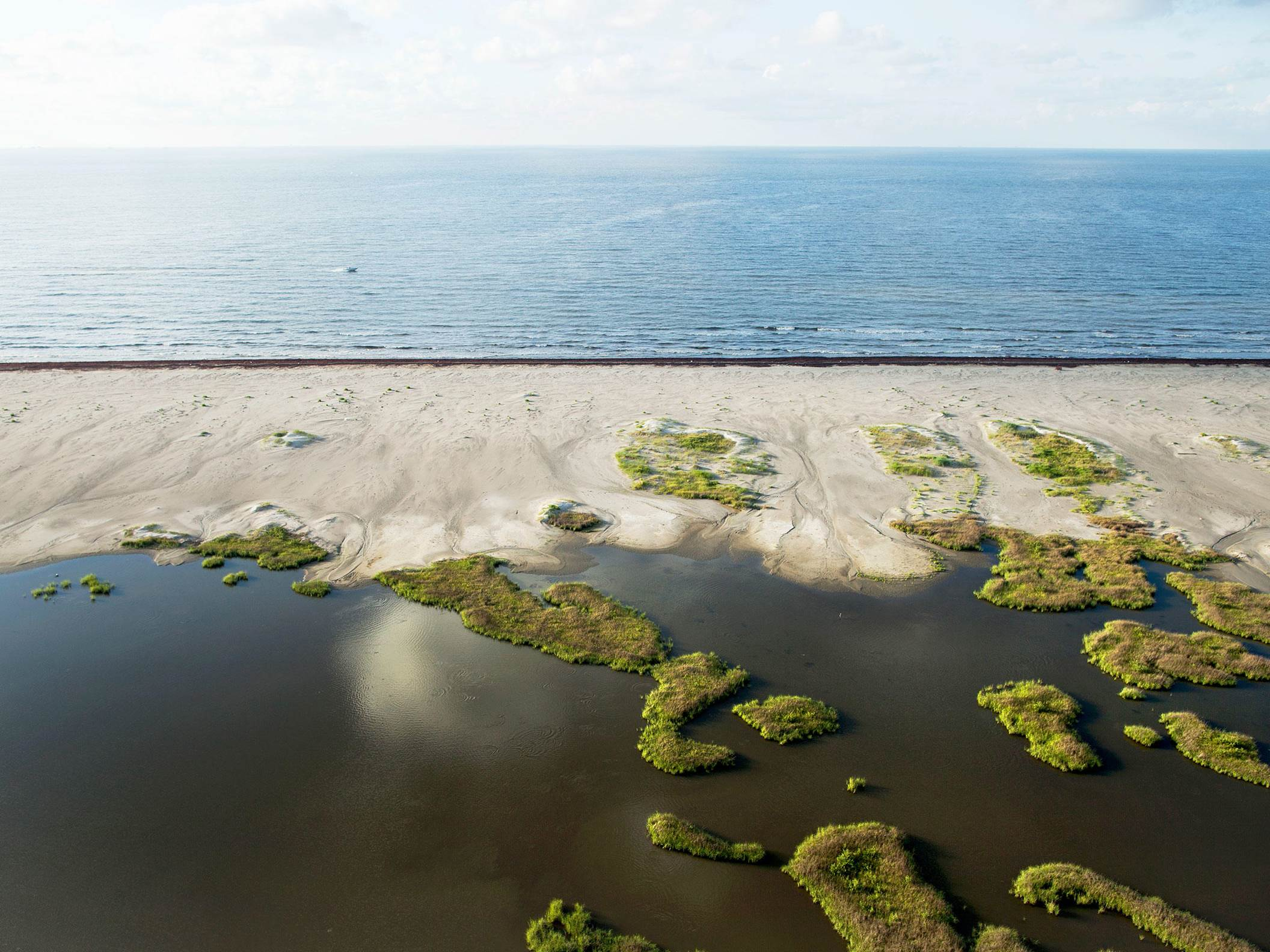 An aerial view of Shell Island East, a barrier island with sand dunes and other habitat also helping with coastal resilience.