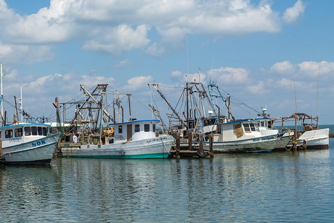 Shrimping boats lined up in the water in Fulton Harbor, Texas.