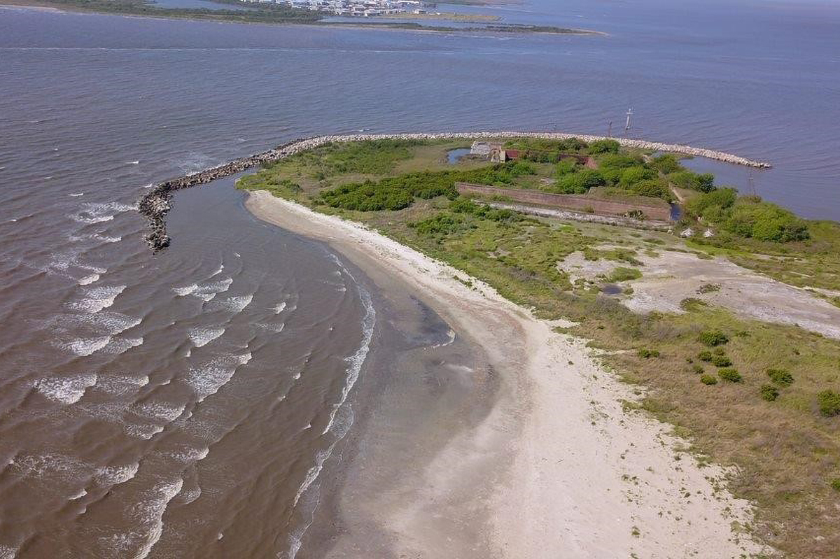 Aerial view of an island with shoreline protection. Credit Providence Engineering.