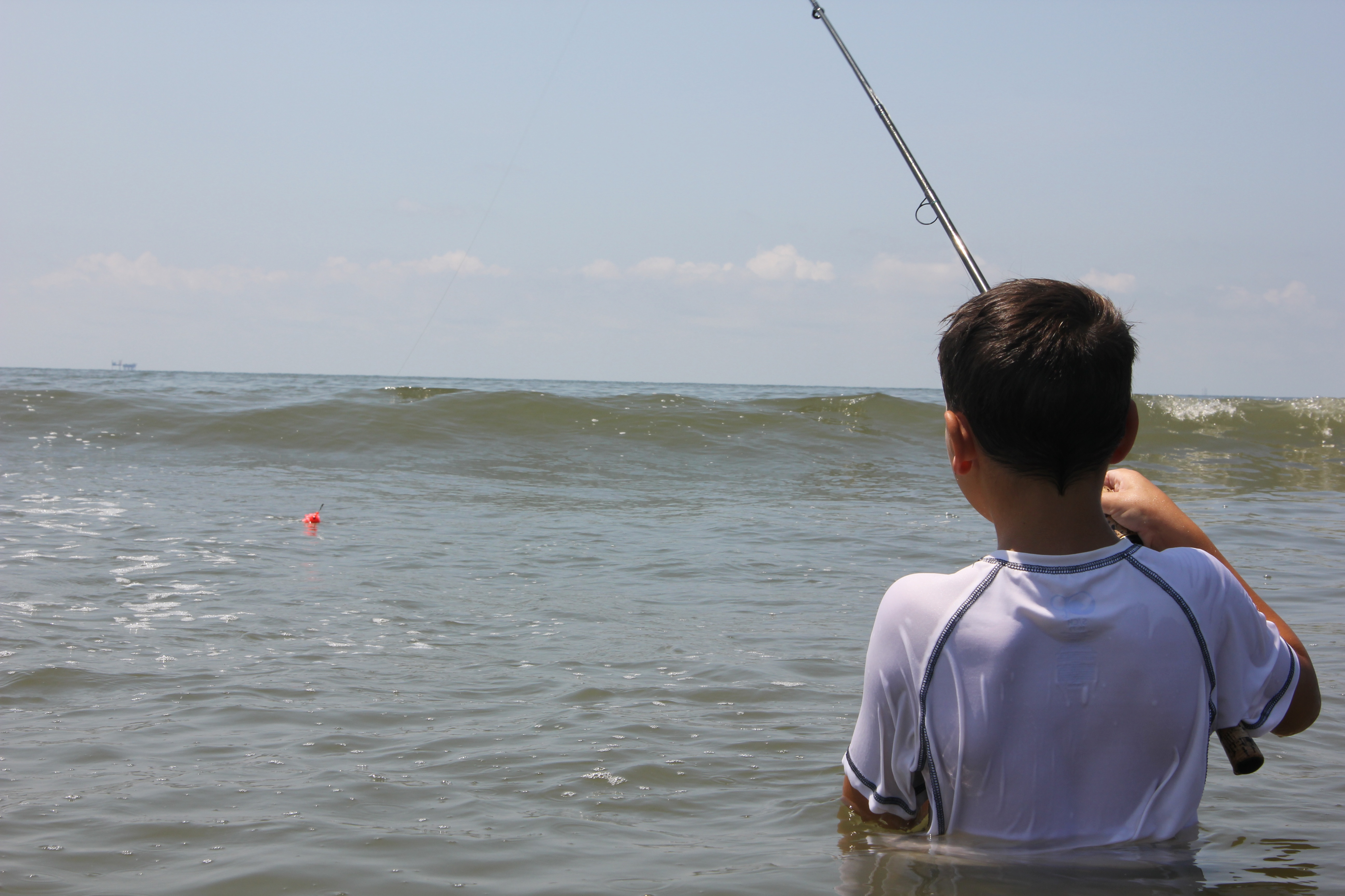 Young angler looking for his catch at Elmer's Island in Louisiana.